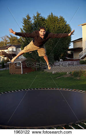 Stock Photo of man jumps on a trampoline; ferndale, washington.