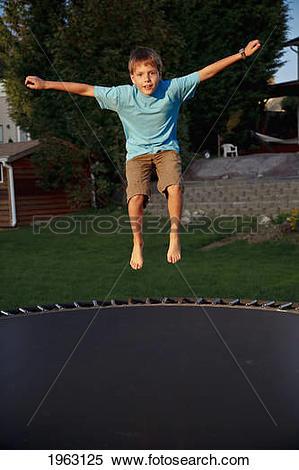 Stock Image of A Boy Jumping On A Trampoline; Ferndale, Washington.