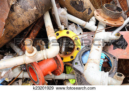 Stock Photograph of iron pipes of a landfill of ferrous material.