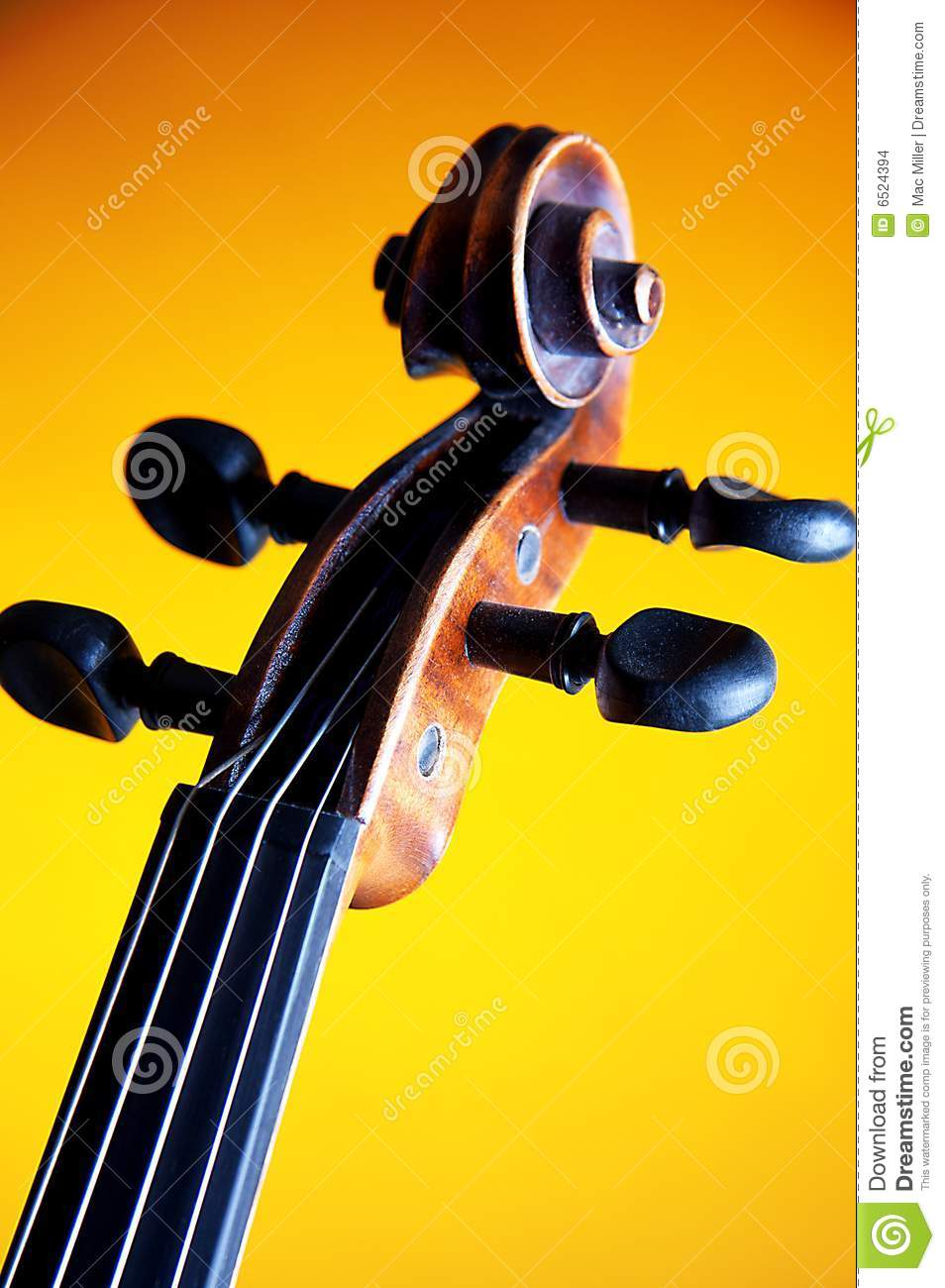 Violin Scroll And F Hole Isolated Against A Yellow Background In.