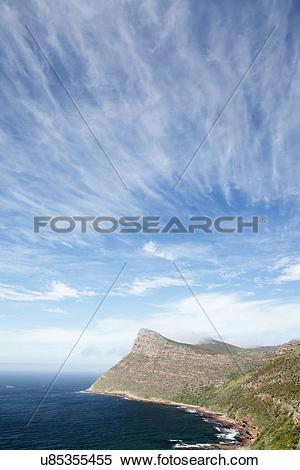 Stock Image of Cirrus fibratus radiatus clouds u85355455.