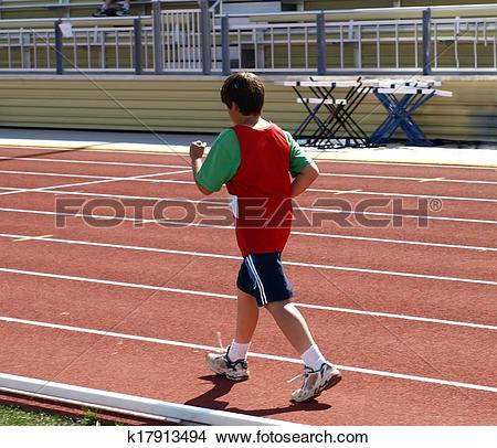 Stock Photo of Boy on track and field competition k17913494.