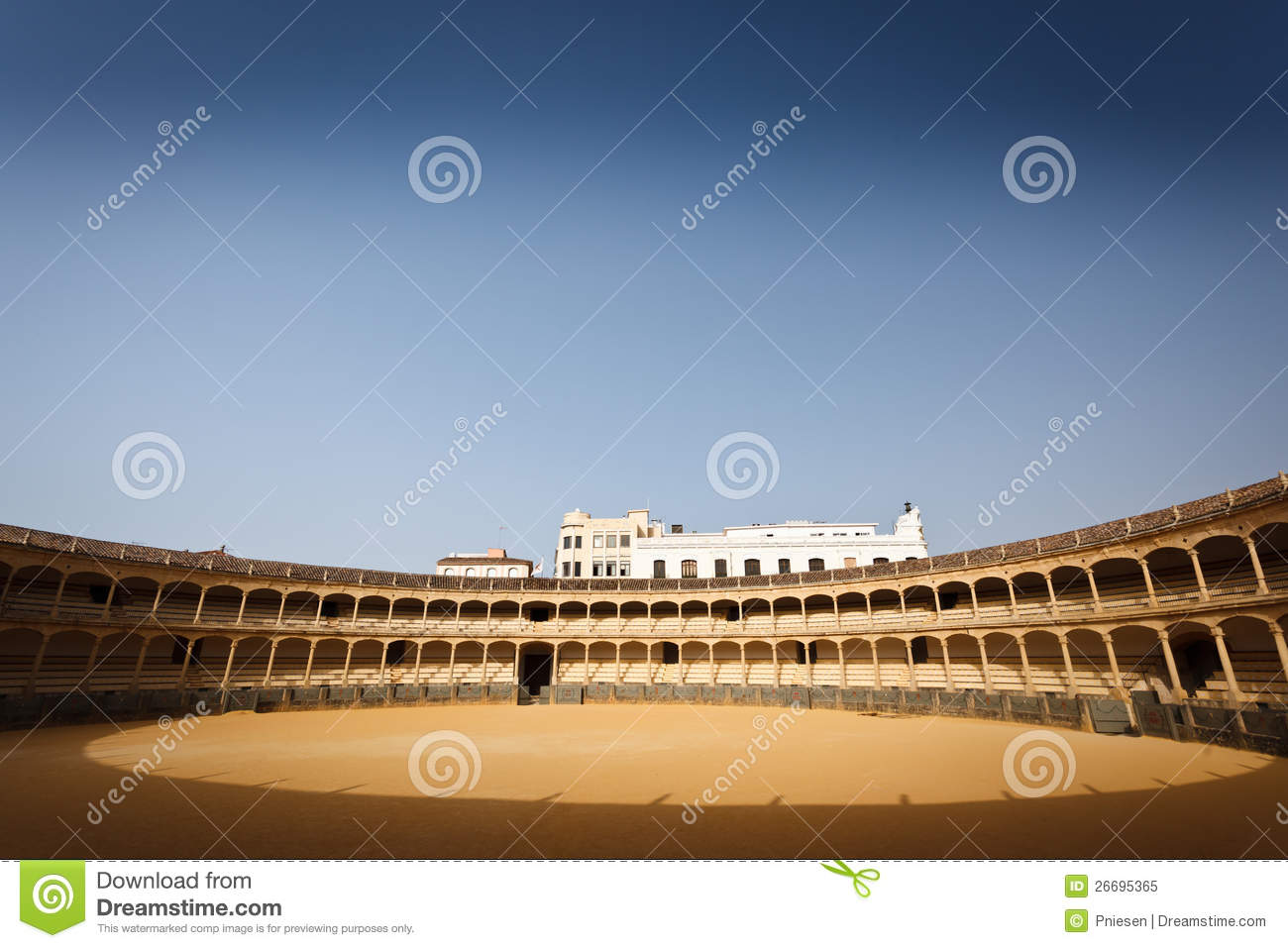 Sunlit Seating And Floor Of Bull Fight Arena Royalty Free Stock.