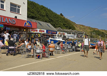 Pictures of England, North Yorkshire, Filey, Holidaymakers eating.