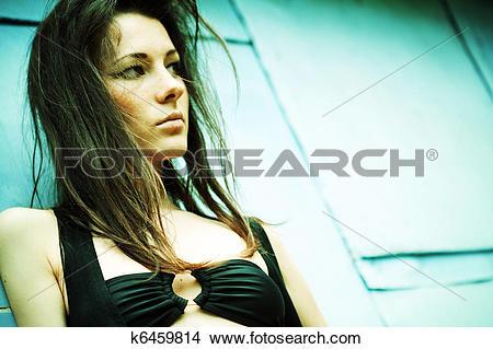 Stock Photo of dramatic female portrait. cross.