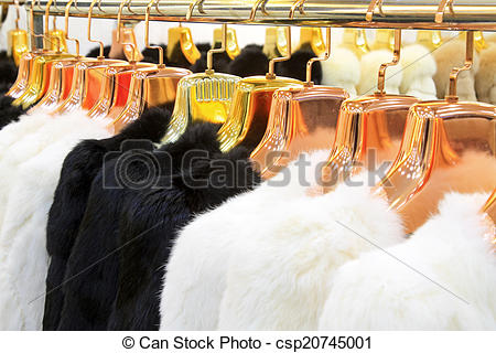 Stock Photography of The Fine fur clothing on hangers in a store.