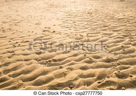 Stock Images of Wet Golden fine grain beach sand wavy texture.