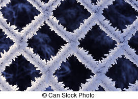 Stock Photography of Fine ice crystals on chainlink fence.