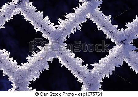 Stock Photography of Fine ice crystals on chain link fence.