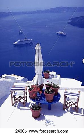 Stock Image of Chairs with potted plants on terrace, Fira.