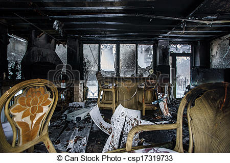 Stock Photos of Fire damaged interior details in summer house.