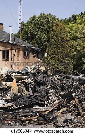 Picture of Fire damaged Cottage style Residential Home next to the.