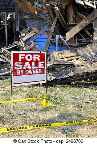 Stock Photography of Fire Damaged Home For Sale.