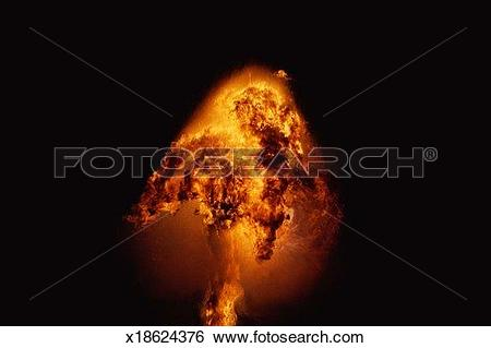 Stock Images of Fire explosion in shape of small mushroom.