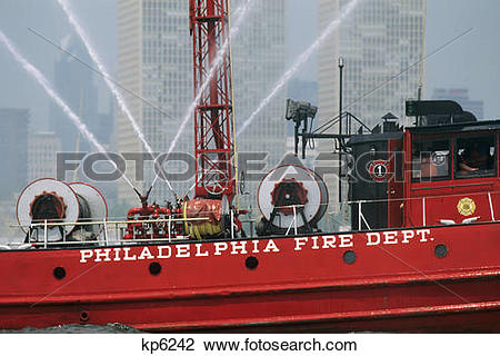 Stock Photo of fire boat delaware shooting water cannon during.