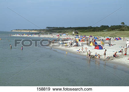 Stock Photograph of Tourists on beach, Fischland.