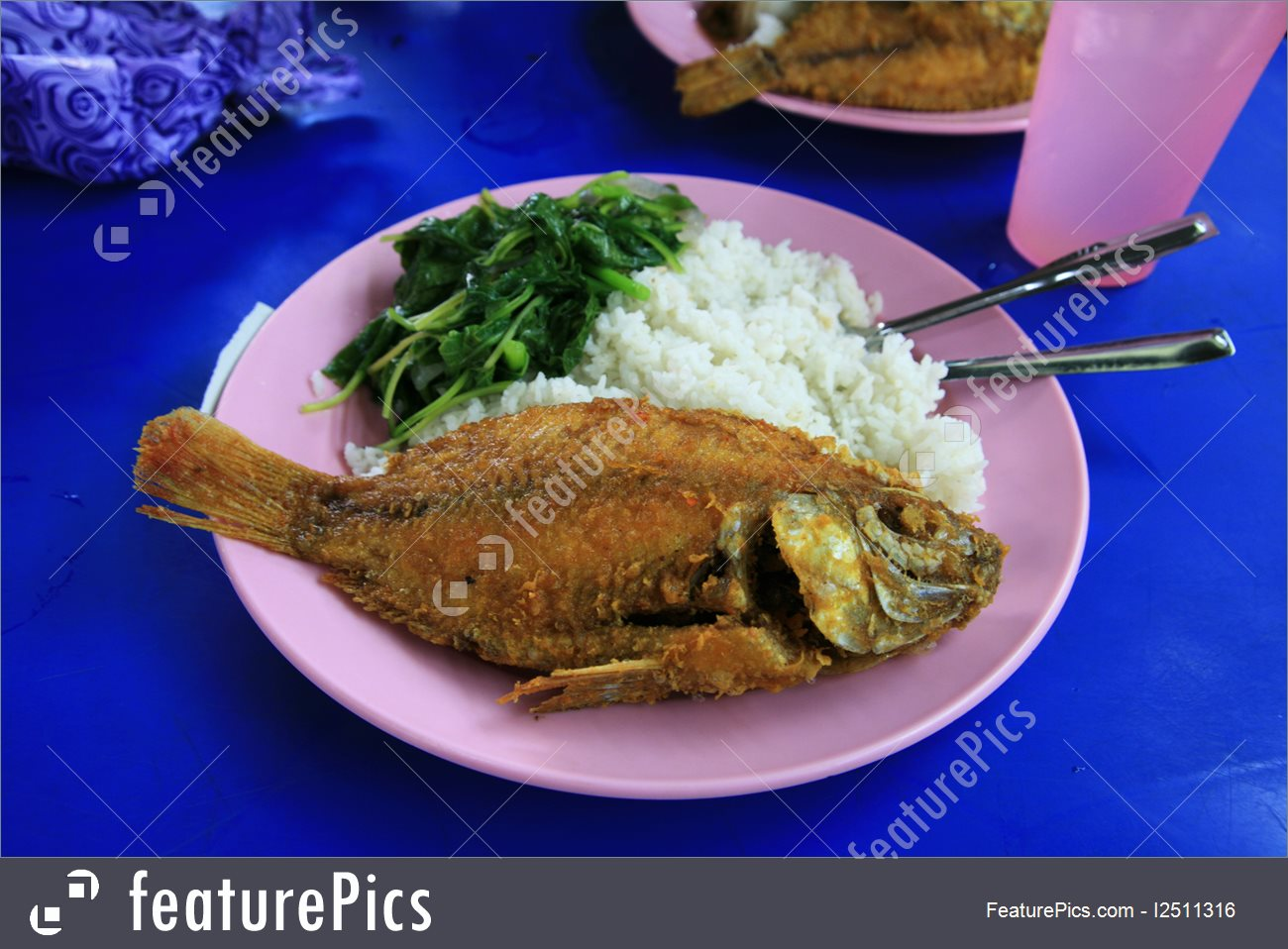 Seafood: Malaysian fried fish with rice and vegetables at a food stall in  Kuala Lumpur.