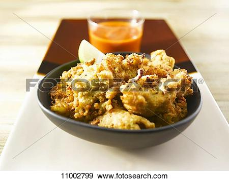 Stock Photograph of Stock fish burgers and pepper.