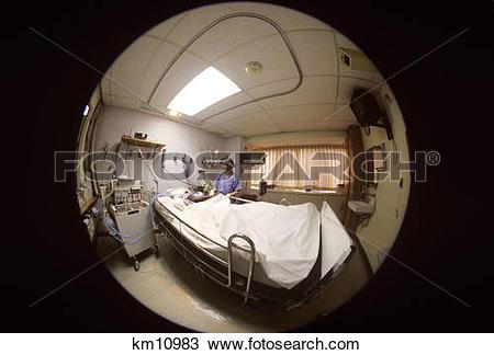 Stock Photo of 1990S Fisheye Lens View Of Nurse Tending Patient In.