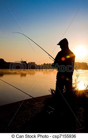 Stock Image of Silhouette of man fishing in a sunset.