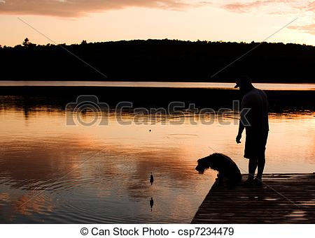 Stock Photographs of man and his dog fishing at sunset csp7234479.