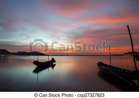 Clip Art of Beautiful silhouette fishing boat in lake at sunset.