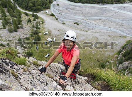 "Stock Photography of ""Female mountain climber climbing a fixed."