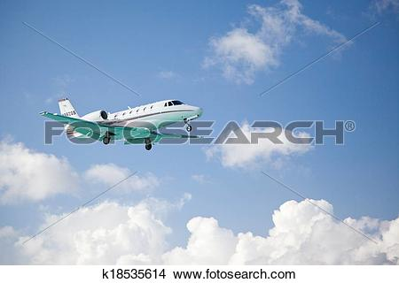 Stock Photo of Small fixed wing plane taking off k18535614.