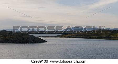Stock Photography of Ocean and fjords looking towards misty.