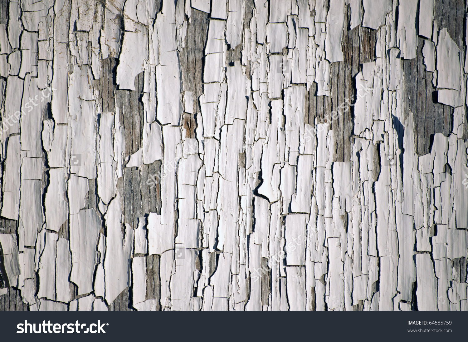 Background Of White, Peeling Paint On An Old Wall Stock Photo.