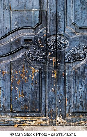 Stock Photography of Rustic Spanish door with flaking paint.