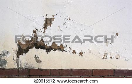 Stock Photo of Flaking Paint on Exterior Wall Indicating Rising.