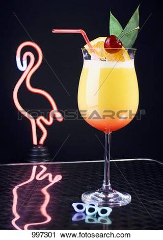 Stock Photography of Cocktail in front of neon flamingo light.