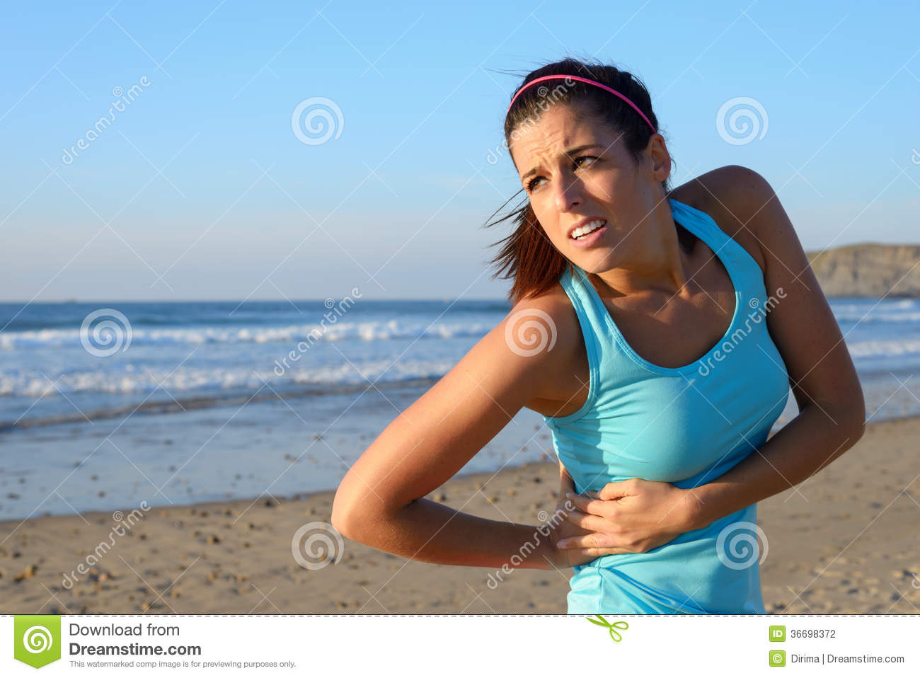 Athlete Suffering Side Kidney Pain Stock Photography.