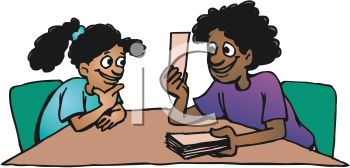 Ethnic Woman Using Flash Cards to Help Her Daughter Learn.