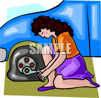 Woman Changing a Flat Tire On Her Car.