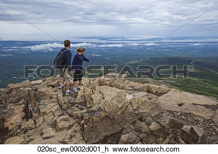 Stock Photo of Couple stand near summit of Flat Top overlooking.