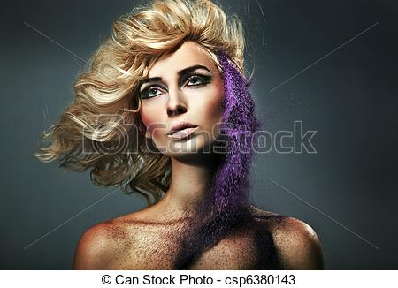 Stock Photos of Young blonde beauty and flecks of colored sand.