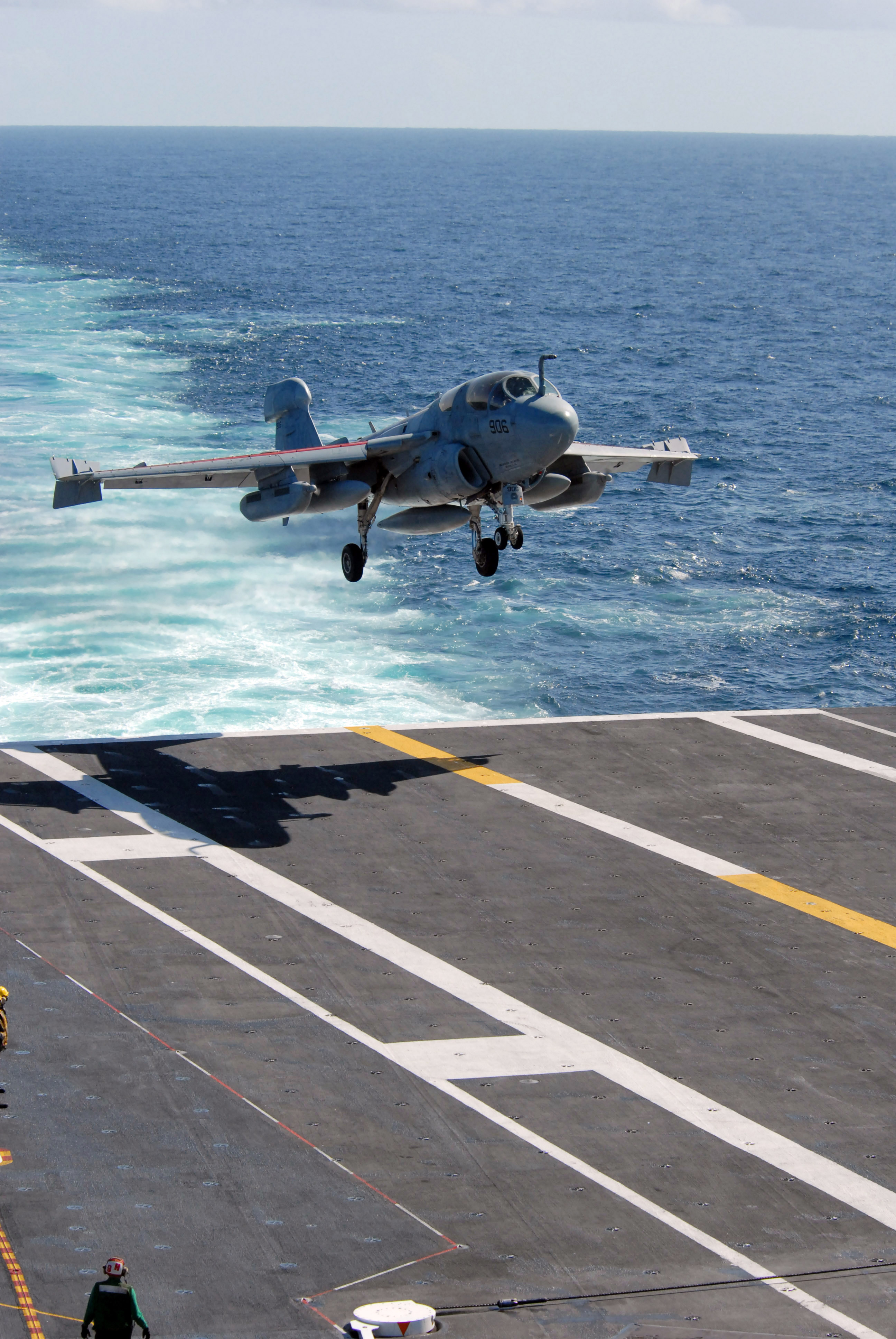 Stock Photography Image: A Jet Landing on an Aircraft Carrier's.