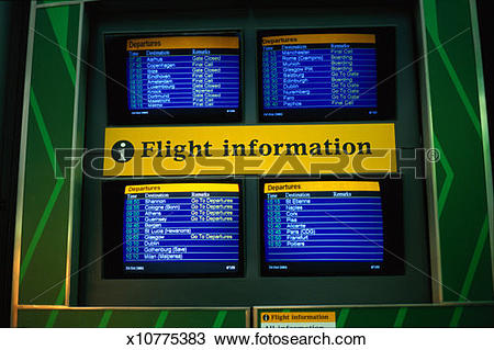 Stock Photo of view of screens displaying flight timings at an.
