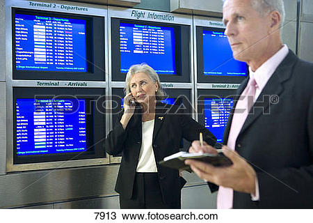 Stock Photo of Business couple standing beside row of flight.