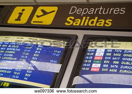 Stock Images of Departures flight information screen at Madrid.