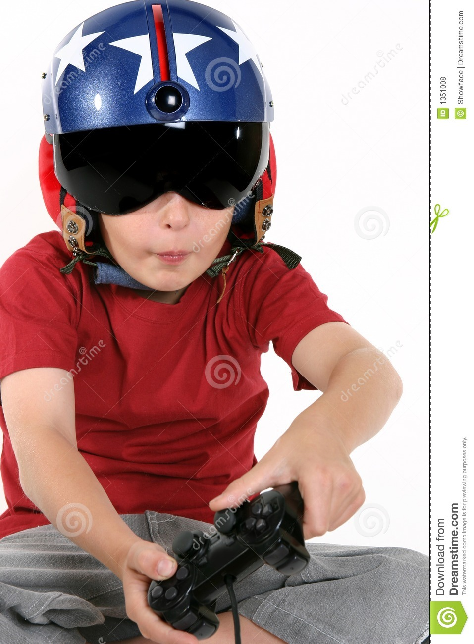 Child In Helmet Playing A Flight Simulator Royalty Free Stock.