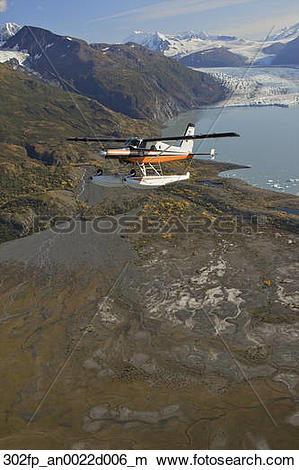 Stock Photo of Turbo Beaver flight seeing over Colony Glacier.