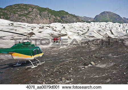 Stock Photography of Tourists walking on Grewingk Glacier during.