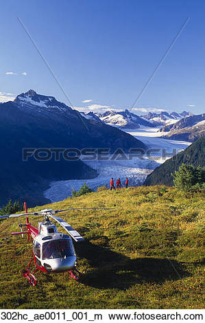 Stock Photo of Tourists enjoy view of Mendenhall Glacier from.