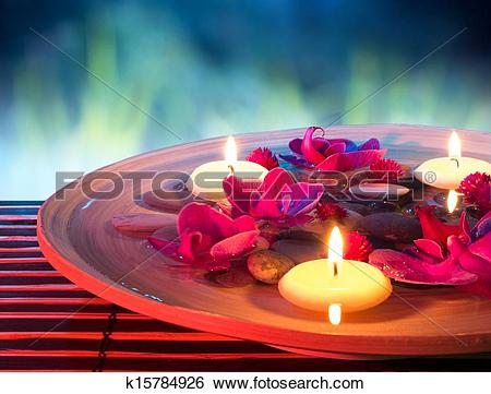 Stock Images of dish spa with floating candles k15784926.