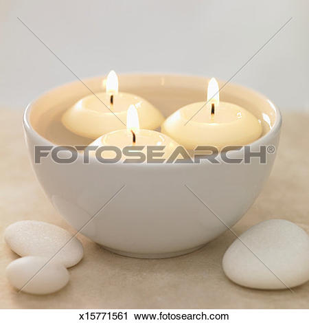 Stock Photography of Floating candles in bowl of water x15771561.