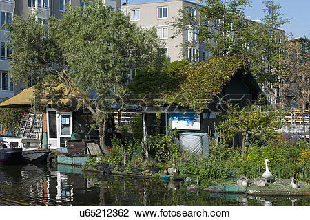 Stock Photo of Floating cottage covered in plants u65212362.