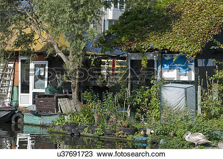 Stock Photo of Floating cottage with plants u37691723.